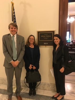 Kimerly Coshow and Tonya Saffer with a member of Sen. Isakson's staff